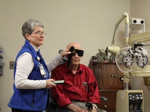 Debra Reeser, an ophthalmology health technician at Mountain Home VA Healthcare System in Tennessee, conducts an eye exam on a veteran in February 2016. Department officials say they expect the number of veterans eligible for VA-backed nursing home care to rise above 1 million in the next five years. (VA photo)
