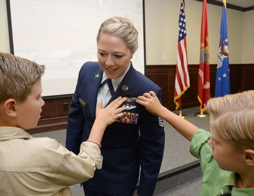 Tech. Sgt. Courtney has her remote piloted aircraft wings pinned on by her sons David and Riley during the 558th Flying Training Squadron's Undergraduate Remotely Piloted Aircraft Training Course graduation August 4, 2017, at Joint Base San Antonio-Randolph, Texas. Courtney is the first-ever enlisted female to qualify as an RPA pilot. (Tech. Sgt. Ave I. Young/Air Force)