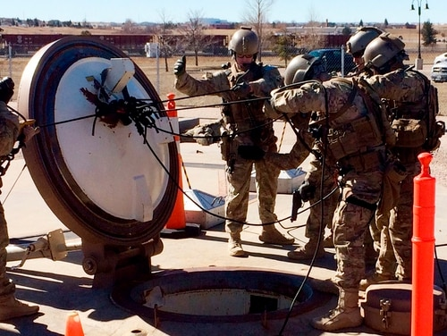 In this February 2016 photo, members of the 790th Missile Security Forces Squadron demonstrate their training for recapturing a Minuteman missile silo after being taken over by an intruder or attacker, just days before the Air Force announced the drug investigation, at the F. E. Warren Air Force Base, near Cheyenne, Wyo. (Robert Burns/AP)