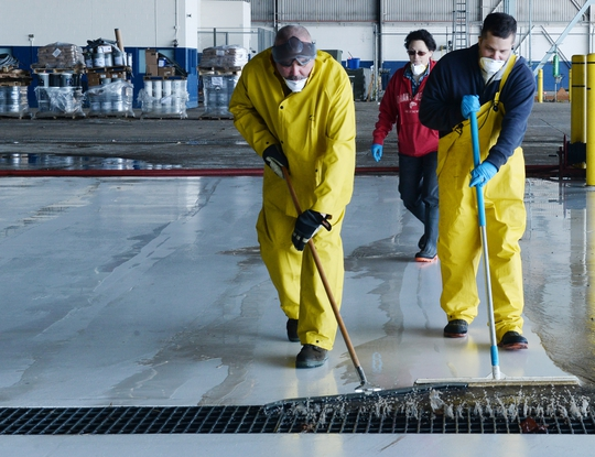 Personnel from Offutt Air Force Base in Nebraska clear debris from one of the docks at the Bennie L. Davis Maintenance Facility on March 21, 2019, less than a week after a large portion of the base was severely flooded. (Charles Haymond/Air Force)