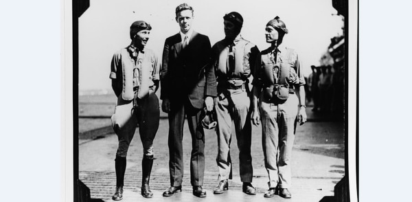 Charles A. Lindbergh, 2nd from left, onboard the aircraft carrier Saratoga with three naval aviators in the late 1920s. Man at left is Lt.j.g. W.V. Davis, one of Fighter Squadron 1B's (VF-1B)