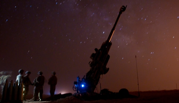 Coalition partners wait near their M777 Howitzer for their next fire mission to assist the Syrian Democratic Forces during Operation Roundup near an outpost near Dashisha, Syria, June 8. (Staff Sgt. Timothy R. Koster/Army)