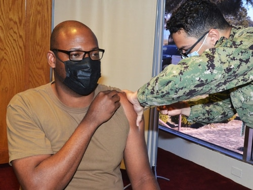 Chief Culinary Specialist Kelly Mathis, of the ballistic-missile submarine Alaska, got his COVID-19 vaccine last month in Jacksonville, Florida.