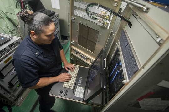 Cloud vendors are coming up with new ideas to provide access for any location, such as aboard a ship. In this picture, a sailor on the amphibious assault ship USS America troubleshoots a server in 2017. (Mass Communication Spc. Vance Hand/U.S. Navy)