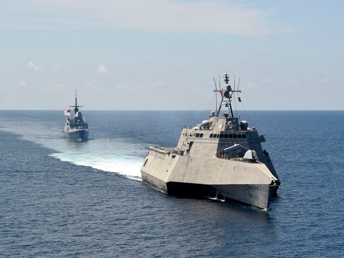 The Independence-variant littoral combat ship USS Gabrielle Giffords (LCS 10), front, exercises with the Republic of Singapore navy Formidable-class multi-role stealth frigate RSS Steadfast (FFS 70) in the South China Sea, May 25, 2020. (MC2 Brenton Poyser/Navy)