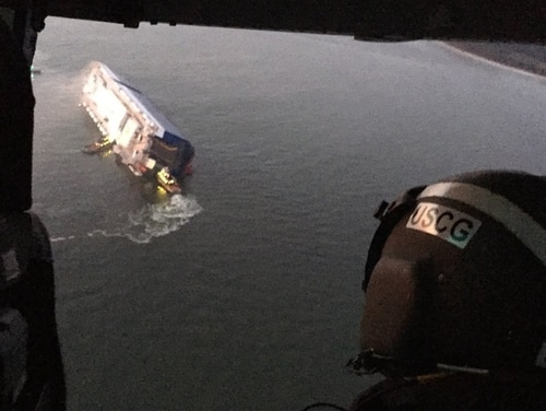 Coast Guard crews and port partners respond to a disabled cargo vessel with a fire on board on Sunday in St. Simons Sound, Georgia. (Coast Guard)