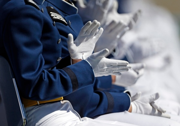 Graduating Air Force Academy cadets applaud during their graduation ceremony for the class of 2015, at the U.S. Air Force Academy, in Colorado Springs, Colo., Thursday, May 28, 2015. (AP Photo/Brennan Linsley)