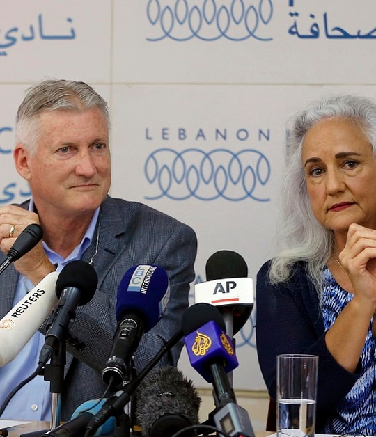 Marc and Debra Tice, the parents of Austin Tice, hold photos of their son during a July 2017 press conference in Beirut, Lebanon. (Bilal Hussein/AP)