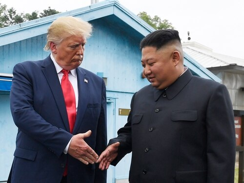 In this June 30, 2019, file photo, North Korean leader Kim Jong Un, right, and U.S. President Donald Trump prepare to shake hands at the border village of Panmunjom in the Demilitarized Zone, South Korea. (Susan Walsh/AP)