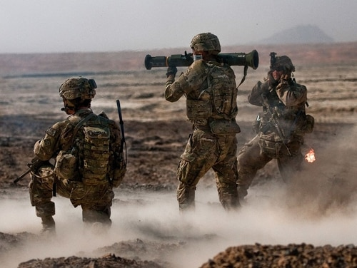 Soldiers shoot an AT4 anti-tank weapon in Kandahar province, Afghanistan. New evidence suggests shoulder-fired weapons like the AT4 can cause traumatic brain injuries in troops. (Staff Sgt. Whitney Houston/Army)
