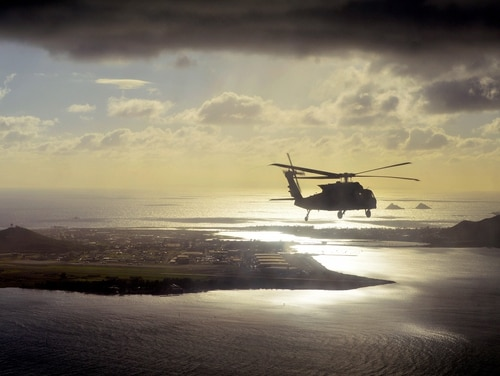 A UH-60 Black Hawk helicopter passes near Marine Corps Air Station Kaneohe Bay, Hawaii, Dec. 2, 2015. (Staff Sgt. Armando Limon/Army)