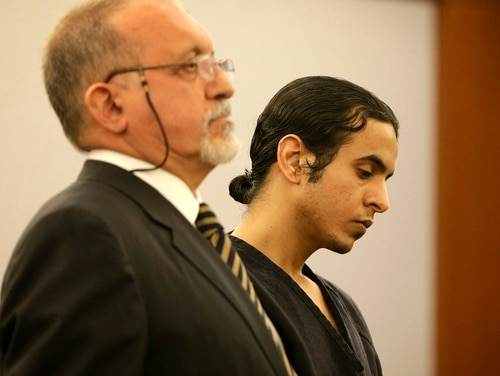 Saudi Arabian air force sergeant Mazen Alotaibi, right, appears in court with attorney Dominic Gentile Wednesday, Jan. 28, 2015, in Las Vegas. Alotaibi will serve at least 35 years in Nevada state prison after being found guilty of kidnapping and sexually assaulting a 13-year-old boy at a Las Vegas Strip hotel. (AP Photo/John Locher)