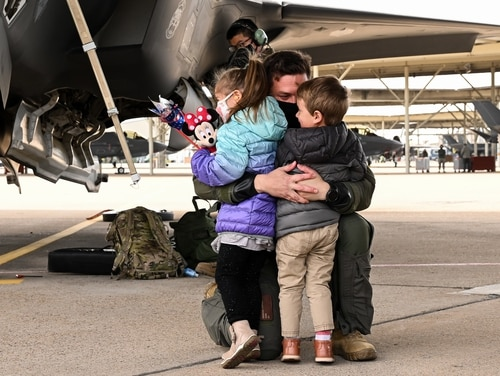 The pandemic has brought additional stressors for military children, on top of experiences like parents' deployments and frequent moves. Pictured here, an unidentified F-35A pilot with the 421st Fighter Squadron reunites with his family at Hill Air Force Base, Utah, Oct. 23, 2020, following a six-month deployment. (R. Nial Bradshaw/Air Force)