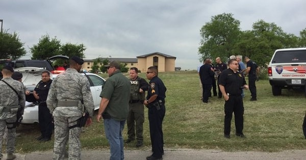 Bexar County, Texas, sheriff's deputies talk with Air Force personnel following the April 8, 2016, shooting death of Lt. Col. William Schroeder at Lackland Air Force Base. (Bexar County Sheriff's Office)