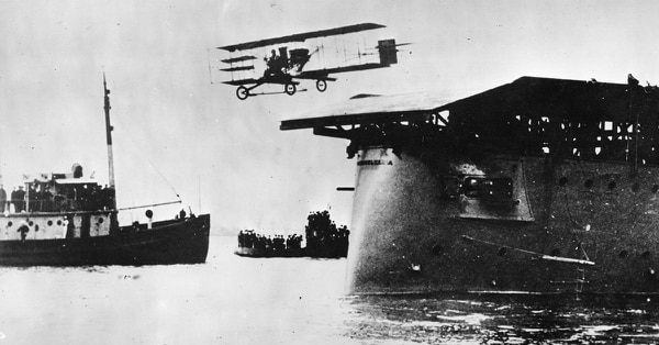 Lieutenant Eugene B Ely, flying a Curtiss biplane, takes off from a launching platform fitted to the armored cruiser USS Pennsylvania to return to an airfield, after the first ever shore to ship aircraft landing off San Francisco. (Hulton Archive/Getty Images)