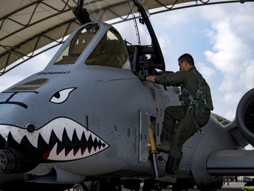 Maj. Matt Paetzhold, an A-10C Thunderbolt instructor pilot with the 76th Fighter Squadron, climbs aboard a Warthog at Moody Air Force Base on Sept. 9, 2017. (SrA Daniel Snider/Air Force)