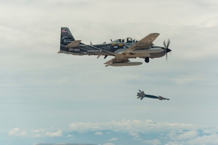 Laser-guided bombs deployed from A-29 Super Tucanos, flying here over White Sands Missile Range, N.M., enable more precise targeting. (Ethan D. Wagner/U.S. Air Force)