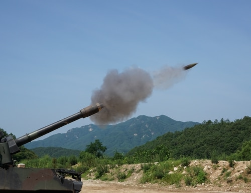 Soldiers from Battery B, 1st Battalion, 82nd Field Artillery Regiment, 1st Armored Brigade Combat Team, 1st Cavalry Division, fire a 155mm round from a M109A6 Paladin self-propelled howitzer at Nightmare Range, near Topyong-ri, South Korea, from July 20. (U.S. Army photo by Capt. John DePinto, 1st Battalion, 82nd Field Artillery Regiment, 1st Armored Brigade Combat Team, 1st Cav. Div.)