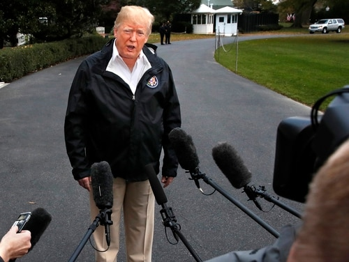 President Donald Trump answers questions from the press as he leaves the White House on Nov. 17, 2018, en route to see fire damage in California. On Monday, he took to social media to walk back comments a day earlier that seemed to blame military commanders for taking too long to capture Osama bin Laden. (Jacquelyn Martin/AP)