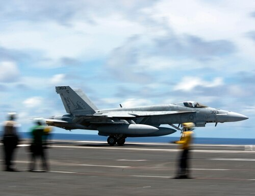 An F/A-18E Super Hornet practices a touch-and-go maneuver on the flight deck of the aircraft carrier USS Ronald Reagan (CVN 76) on June 10, 2020, in the Philippine Sea. (MC2 Samantha Jetzer/U.S. Navy via AP)