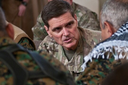 Then-Army Gen. Joseph Votel, commander of U.S. Central Command, speaks with a commander of Syrian Democratic Forces in Syria's Middle Euphrates River Valley on April 22, 2018,, during a meeting in Dawr Az Zawr Province. (Staff Sgt. Timothy R. Koster/Army)