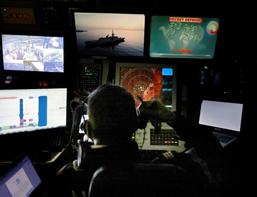 French Navy soldiers work at the tactical operations center on board of the French warship stealth frigate La Fayette, on October 26, 2020, as the frigate sails off Syria, Lebanon, Cyprus and Turkey. The navy, along with the other services, is in line to get a new, joint signals-intelligence suite aboard its major ships. (Photo by THOMAS COEX/AFP via Getty Images)
