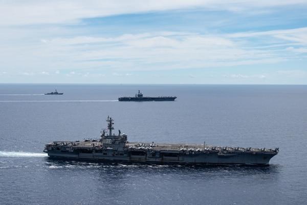 The U.S. Navy aircraft carriers Ronald Reagan and Nimitz sail together in the South China Sea. (MC3 Jason Tarleton/U.S. Navy)