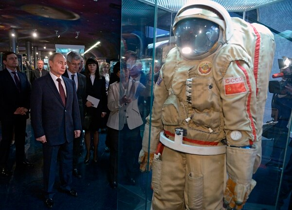 Russian President Vladimir Putin, foreground left, looks at exhibits as he visits the Cosmonautics Memorial Museum in Moscow, Russia, on April 11, 2014. (Alexei Nikolsky/Sputnik via AP)