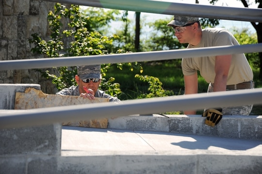 Oregon Air National Guardsmen install a wheelchair ramp at a medical facility in Mangalia, Romania, in May 2015 as part of an effort o make local facilities there more accessible to disabled individuals. (Staff Sgt. Brandon Boyd/Air National Guard)