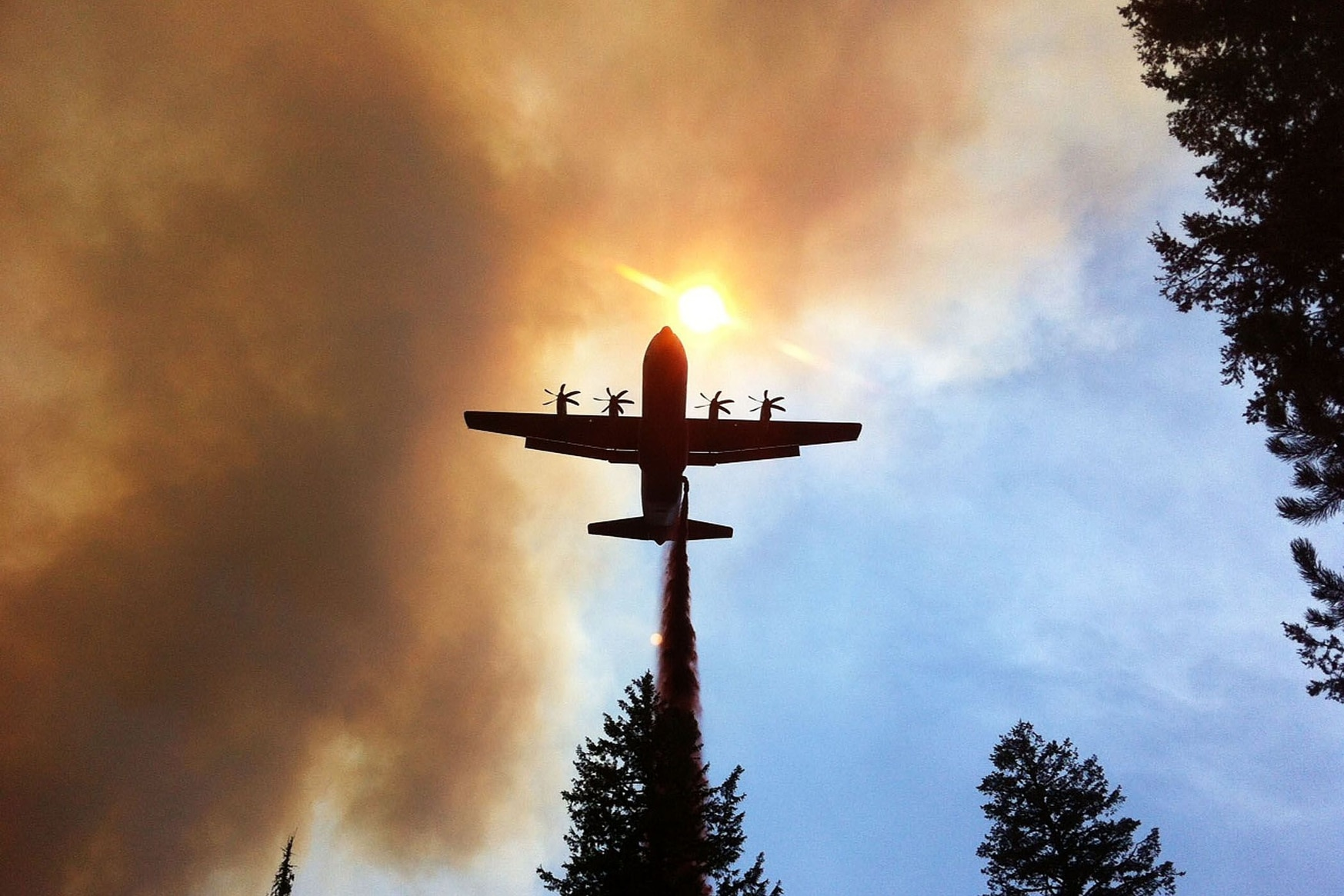 Low-level flights like this firefighting efforts in a California Air National Guard C130-J Hercules could become a challenge if altimeters start to fail. (DoD photo)