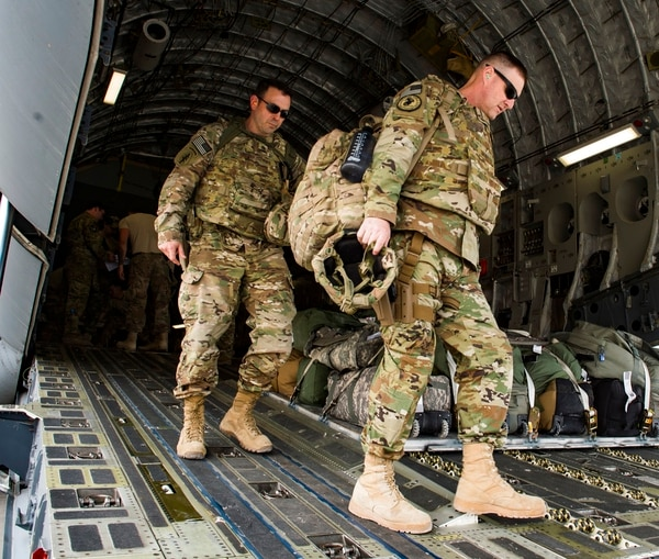 U.S. service members depart a C-17 Globemaster III conducting combat airlift operations for U.S. and coalition forces in Iraq and Syria on April 13, 2018. (Tech. Sgt. Gregory Brook/U.S. Air Force via AP)