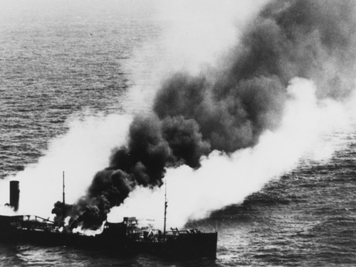 The American steam tanker Harry F. Sinclair Jr. burns south of Cape Lookout North Carolina, after being torpedoed by German submarine U-203 on April 11, 1942. Carrying a shipment of gasoline, the vessel had been steaming alone, bound from Houston to Norfolk. (National Archives)