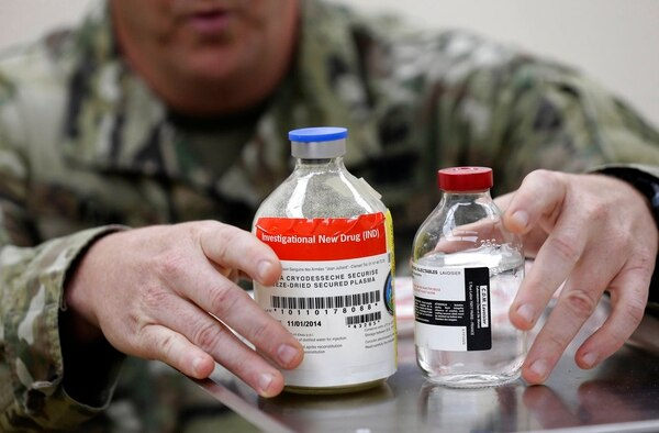 In this Wednesday, Nov. 8, 2017, photo, Army Col. Shawn Kane displays the components of freeze-dried plasma at Fort Bragg, N.C. (Gerry Broome/AP)