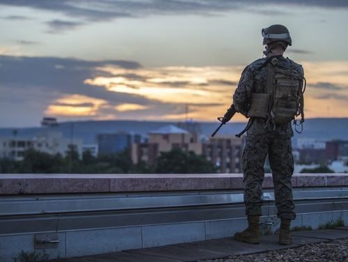 A U.S. Marine Security Guard (MSG) watchstander provides security while standing post on the roof of the U.S. Embassy, Bamako, Mali. (Staff Sgt. Sarah Nadeau/Marine Corps)