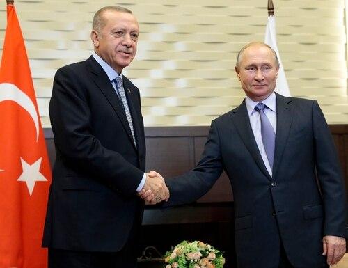 Russian President Vladimir Putin, right, and Turkish President Recep Tayyip Erdogan pose for a photo during their meeting in the Bocharov Ruchei residence in the Black Sea resort of Sochi, Russia, Tuesday, Oct. 22, 2019. (Sergei Chirikov/Pool via AP)