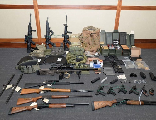 Authorities found 15 guns and more than 1,000 rounds of ammunition when they searched the apartment of Coast Guard Lt. Christopher Paul Hasson. Prosecutors allege he was a self-proclaimed white nationalist plotting