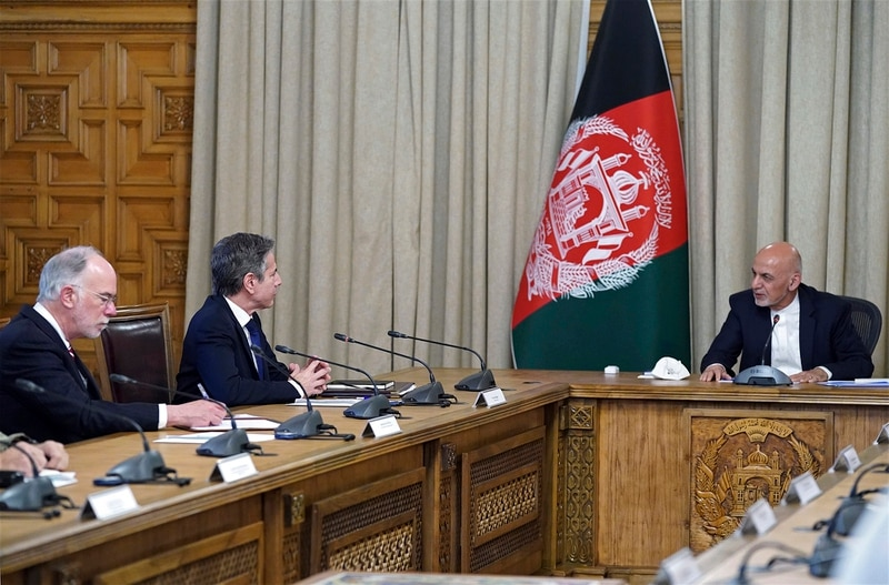 In this April 15, 2021, file photo Afghan President Ashraf Ghani, right, meets with U.S. Secretary of State Antony Blinken, second left, and their delegations, at the presidential palace in Kabul, Afghanistan. (Afghan Presidential Palace via AP)
