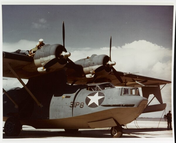 Aviation machinist's mates work on the starboard engine of a VP-31 Consolidated PBY-5A