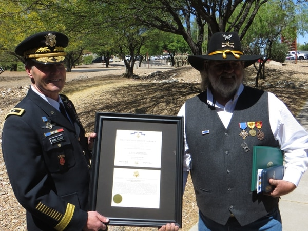 Frank Crary shows the citation for his Distinguished Service Cross after the ceremony at Fort Huachuca, Arizona, on Tuesday. (Army)