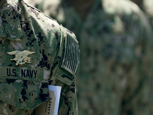 """Members of SEAL Qualification Training Class 336 wear their newly earned Special Warfare (SEAL) pins, known as """"Tridents,"""" during their graduation ceremony at Naval Special Warfare (NSW) Center in Coronado, Calif., April 15, 2020. (MC1 Anthony W. Walker/Navy)"""