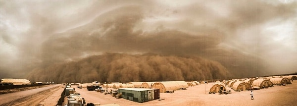 A sand storm moves in at Nigerien Air Base 201, Niger, in June. Dust storms are just some of the weather complications that make construction in the Sahara difficult. (Airman 1st Class Thomas Jamison/Air Force)