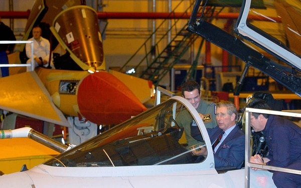 Britain's Prince Charles sits in the cockpit of a Eurofighter Typhoon during a tour of BAE Systems' Warton Aerodrome in Preston, England. (Bruce Adams/AP)