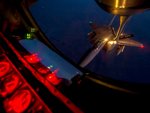 An F-15E Strike Eagle receives fuel from a KC-135 Stratotanker Sept. 23, 2014, over northern Iraq after conducting airstrikes in Syria. (Senior Airman Matthew Bruch/Air Force)
