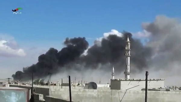 In this image made from video provided by Homs Media Centre, which has been verified and is consistent with other AP reporting, smoke rises after airstrikes by military jets in Talbiseh of the Homs province, western Syria, Wednesday, Sept. 30, 2015. Russian military jets carried out airstrikes in Syria for the first time on Wednesday, targeting what Moscow said were Islamic State positions. U.S. officials and others cast doubt on that claim, saying the Russians appeared to be attacking opposition groups fighting Syrian government forces. (Homs Media Centre via AP)