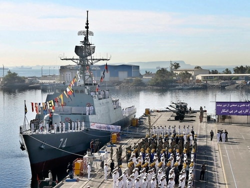 Iranian naval forces attend a Dec. 1 inauguration ceremony for the destroyer Sahand, in Bandar Abbas, Iran. (Iranian Army via AP)