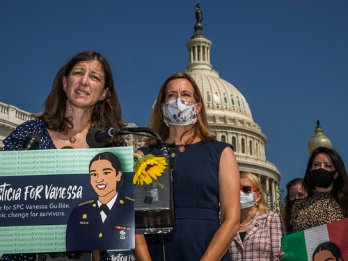 U.S. Naval Academy graduates Rep. Elaine Luria, D-Va., left, and Rep. Mikie Sherrill, D-N.J., center, speak during a news conference on Capitol Hill about ending sexual harassment and assault in the U.S. military on July 21, 2020. (Manuel Balce Ceneta/AP)