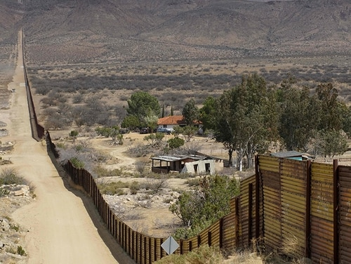 Houses are seen on the Mexican side of the US/Mexico border fence on April 6, 2018, in Jacumba, California. (Sandy Huffaker/AFP/Getty Images) NORTHCOM official said Marine fired weapon on May 29, 2019 while posted at border near El Centro, California.