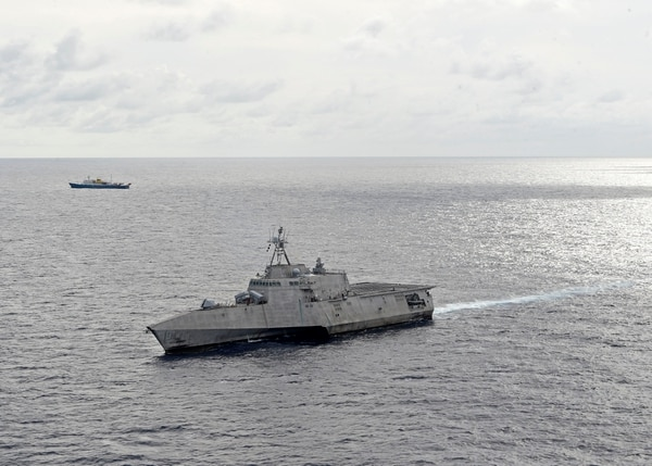 The Independence-variant littoral combat ship USS Gabrielle Giffords (LCS 10), right, conducts routine operations in the vicinity of the Chinese vessel Hai Yang Di Zhi 4 Hao, July 1, 2020, in the South China Sea. MC2 Brenton Poyser/US Navy.
