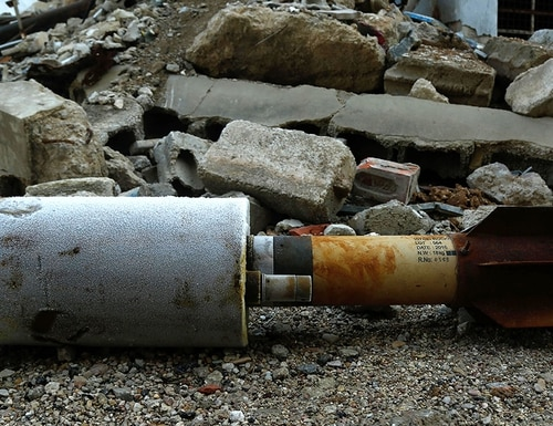 A close up shot shows an empty rocket reportedly fired by regime forces on the rebel-held besieged town of Douma in the eastern Ghouta region on the outskirts of the capital Damascus on Jan. 22, 2018. (Hasan Mohamed/AFP/Getty Images)