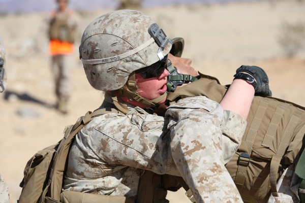 Cpl. Katie M. Gorz, team leader with 2nd Platoon, Company A, Ground Combat Element Integrated Task Force, conducts a fire-team assisted carry during a simulated casualty evacuation portion of a Marine Corps Operational Test and Evaluation Activity assessment at Range 107, Marine Corps Air Ground Combat Center Twentynine Palms, March 9, 2015. From October 2014 to July 2015, the GCEITF will conduct individual and collective level skills training in designated ground combat arms occupational specialties in order to facilitate the standards-based assessment of the physical performance of Marines in a simulated operating environment performing specific ground combat arms tasks.